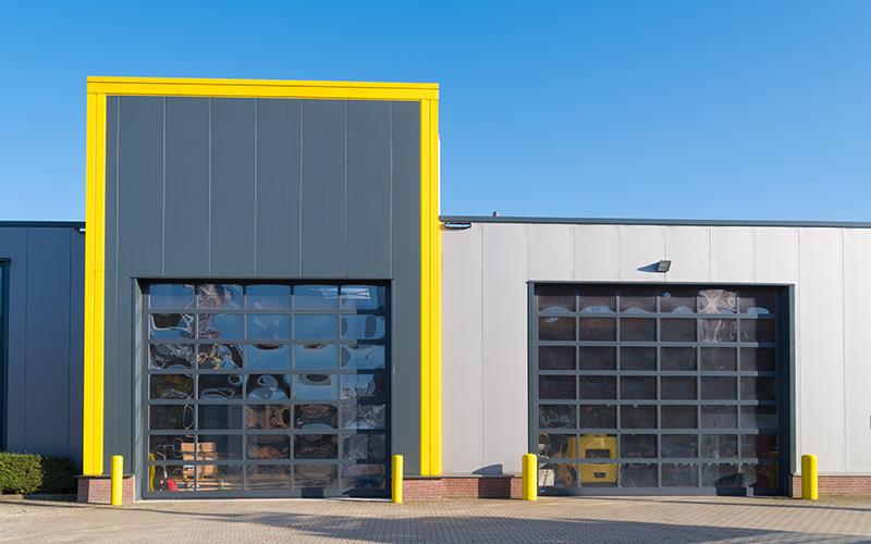 Industrial garage unit with roller doors